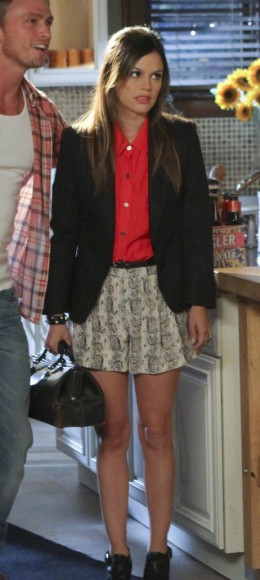 Zoe's red top and patterned shorts