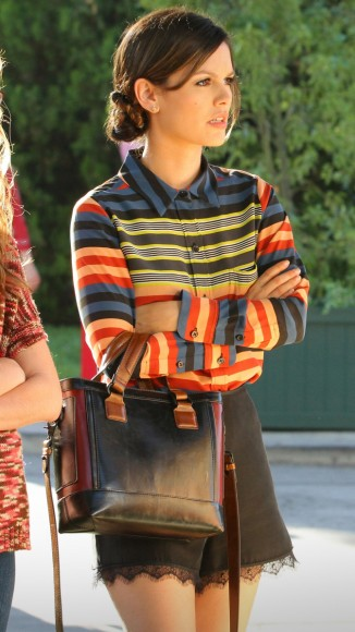 Zoe's striped top and black/brown handbag