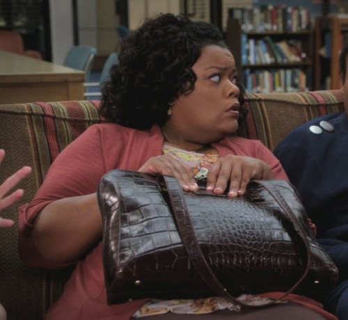 Shirley's brown leather bag on Community