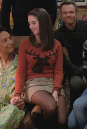Annie's orange reindeer sweater