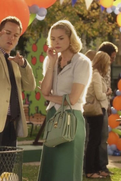 Lemon's green handbag and fluffy cardigan