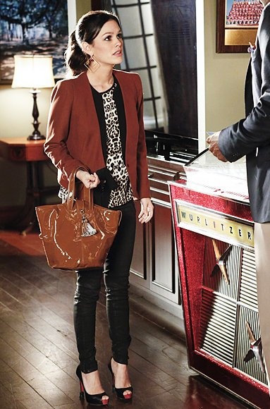 Zoe's leopard print shirt and rust colored blazer with gold diamond shaped earrings on Hart of Dixie