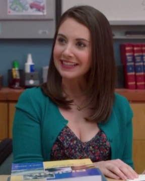 Annie's floral dress and green cardigan on Community