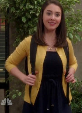 Annie's navy dress and yellow cardigan on Community