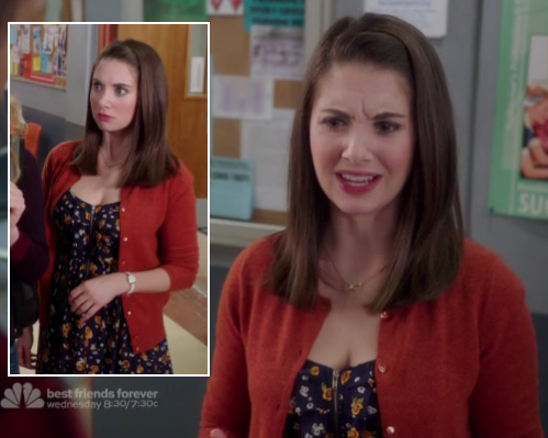 Annie's black floral dress and orange cardigan on Community