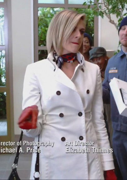 Jane's white coat with red gloves on Happy Endings