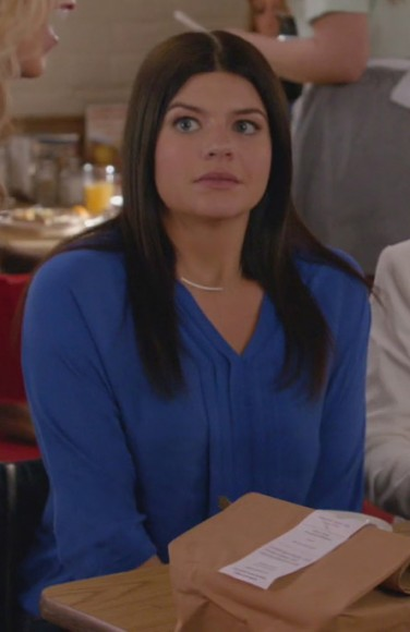 Penny's royal blue blouse on Happy Endings