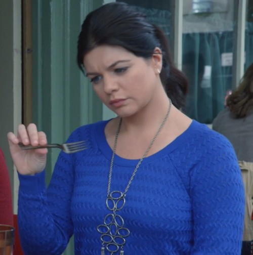 Penny's cobalt blue sweater with circle necklace on Happy Endings