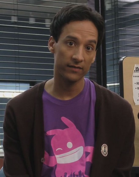 Abed's purple shirt with pink character on it on Community
