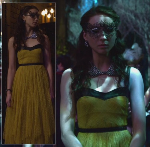 Spencers yellow gown with leather trim at the masquerade gala on PLL