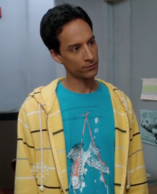 Abed's blue shoe graphic shirt with yellow striped hoodie on Community