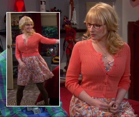 Bernadette's orange pointelle cardigan over a floral dress and brown tights on The Big Bang Theory