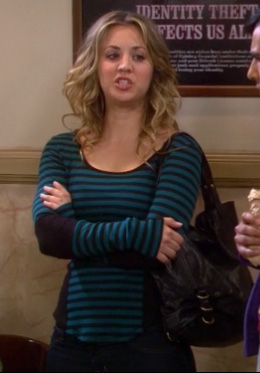 Penny's blue striped longsleeve top and black handbag on The Big Bang Theory