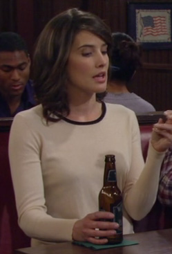 Robin's cream longsleeve top with black neck trim on How I Met Your Mother