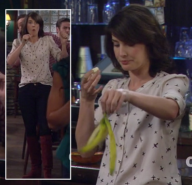 Robin's white bird pattern top with red boots on HIMYM