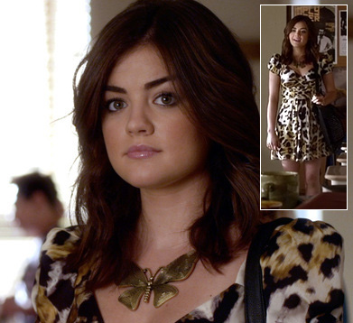 Aria's big gold butterfly necklace and leopard print dress on Pretty Little Liars