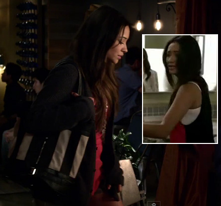 Emily's pink and black contrast back top with striped bag on Pretty Little Liars