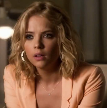Hanna's peach blazer and studded hoop earrings on Pretty Little Liars