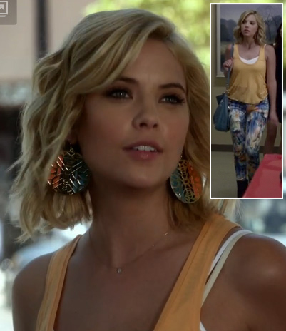 Hanna's peach tank top, floral jeans and circle earrings on Pretty Little Liars
