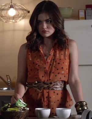 Aria's orange polka dot top and leopard print belt on PLL