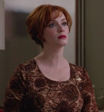 Joans brown rose print dress on Mad Men