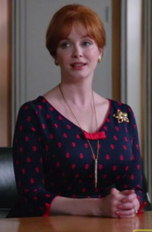 Joan's navy and red polka dot dress with bow on Mad Men