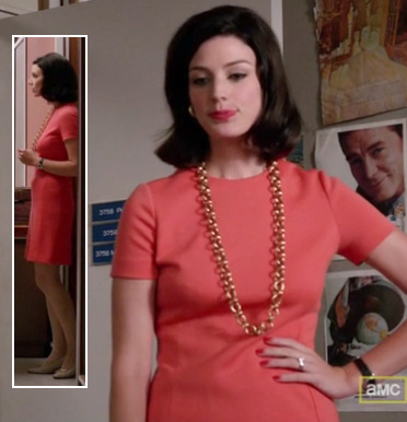 Megan's coral dress and gold chain necklace on Mad Men