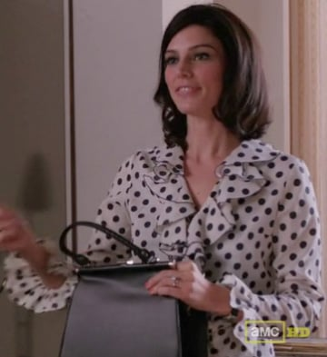 Megan Draper's white polka dot ruffle top on Mad Men