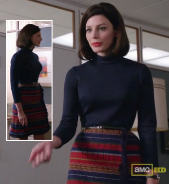 Megan Draper's striped wrap skirt and navy turtleneck on Mad Men