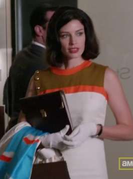 Megan's white dress with khaki and orange on Mad Men