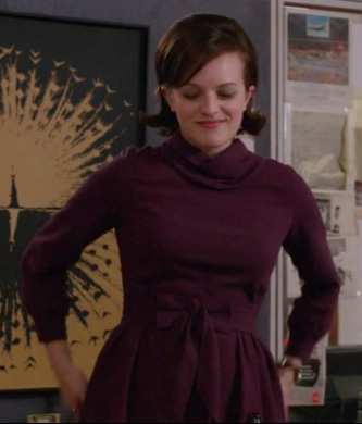Peggy's purple cowl neck dress with bow on Mad Men