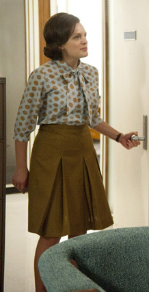 Peggy's mustard pleated skirt and printed blouse on Mad Men