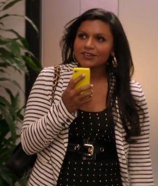 Mindy's polka dot top, striped cardigan and yellow iphone cover on The Mindy Project