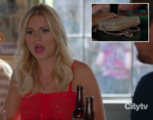 Alex's red lace top and cream studded purse on Happy Endings