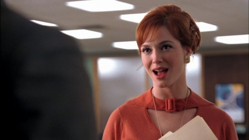 Joan's orange cutout top on Mad Men