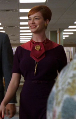 Joan's purple dress with pink tie on Mad Men