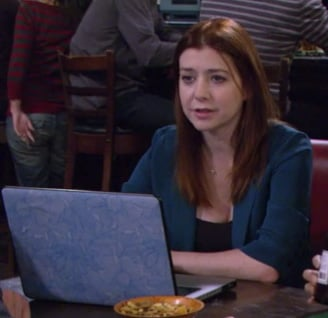 Lily's teal blue blazer and blue floral laptop cover on How I Met Your Mother