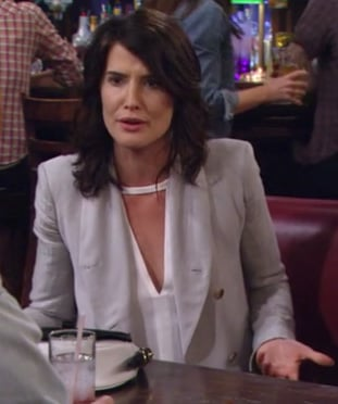 Robin's white cutout blouse and light grey blazer on How I Met Your Mother