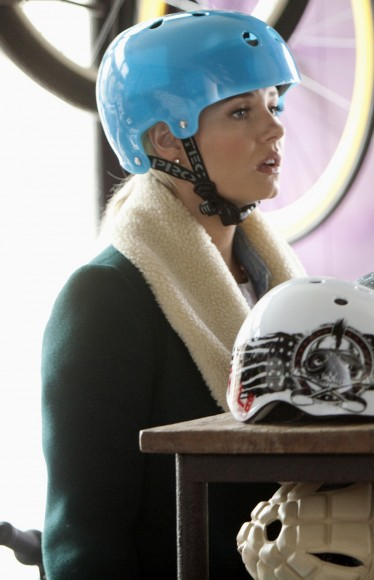 Elisha Cuthberts green shearling coat and blue helment on Happy Endings