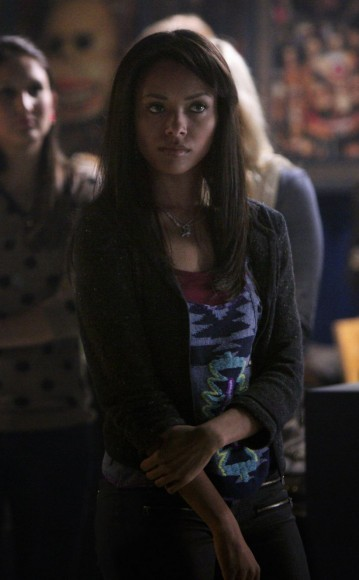 Bonnie's purple aztec printed tank top and black zip pants on The Vampire Diaries