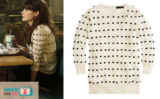 Jess's white sweater with black polka dots/pom poms on New Girl