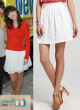 Jess's white eyelet skirt and red button-back sweater on New Girl
