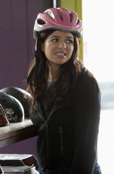 Penny's black jacket and pink helmet on Happy Endings