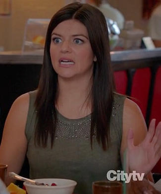 Penny's green studded top on Happy Endings