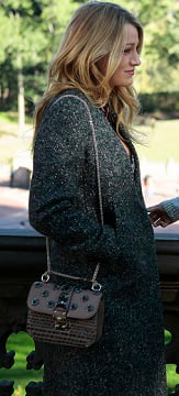 Serena's grey coat and brown purse on the Gossip Girl finale