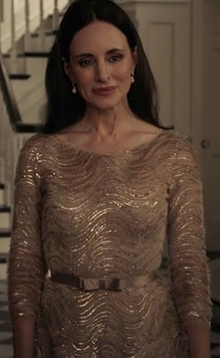 Victoria's gold dress with swirls and bow belt on Revenge