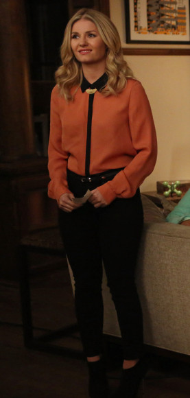 Elisha Cuthbert's orange and black shirt on Happy Endings