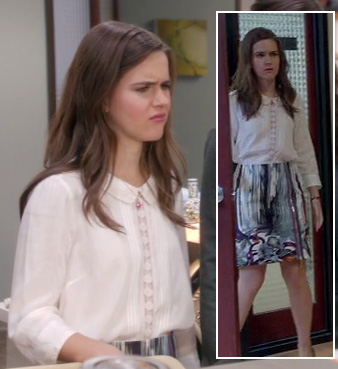 Betsey's white peter pan collar blouse and purple/blue stripe skirt on The Mindy Project