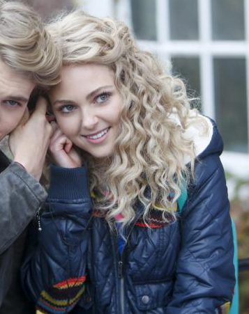Carrie's blue puffer jacket with rainbow patches on The Carrie Diaries