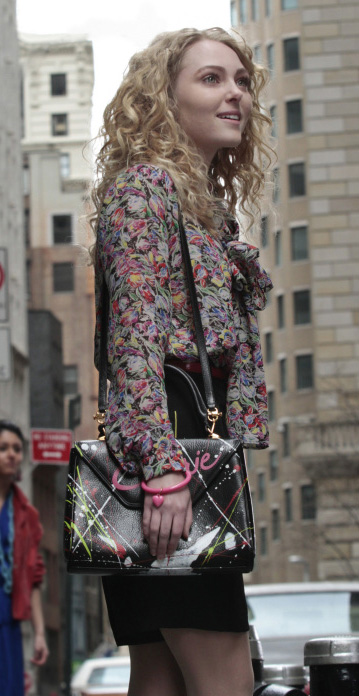 Carrie's floral blouse with bow and black paint splatter bag on The Carrie Diaries